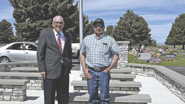 David Peck Lovell Cemetery District board members Jack Nicholls (left) and Todd Herman pose at the newly completed veterans memorial and special events facility at the cemetery. The district funded the project in partnership with the Big Horn Rural Electric Co.