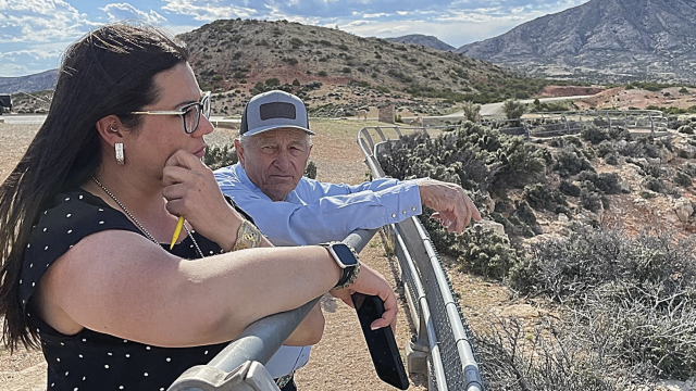 courtesy photo Keith Grant chats with Rep. Liz Cheney's senior agriculture policy advisor, Holly Kennedy, at the Devil's Canyon overlook during a tour of the Bighorn Canyon National Recreation Area Friday evening.