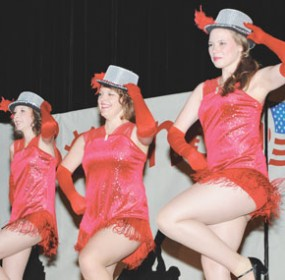 "Sporting brand new outfits, Rose City Rockettes (l-r) Ashton May, Bekka Schroeder and Maddison Baxendale kick up their heels to the tune of ""One"" during the Mustang Days Follies Tuesday night at the Hyart. (June 23, 2011 photo)"
