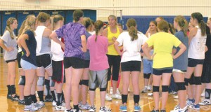 Coach Stormy Jameson gives feedback to a group of players after an afternoon practice session at Lovell High School.