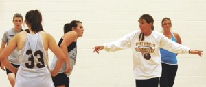 RMHS Coach Carol McMillin gives some pointers to a group of players during a practice session that was held on Aug. 22