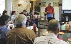Fisheries biologist Mark Smith (back of room) talks to the Lovell Area Chamber of Commerce about re-establishing the Yellowstone Cutthroat Trout during the chamber's general membership meeting Monday. Patti Carpenter photo