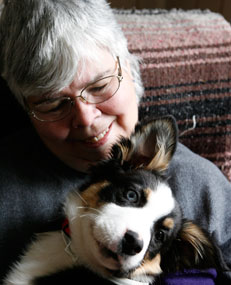Karyn Felt enjoys a moment with Izzy, the pup she adopted from the shelter in Lovell last week.