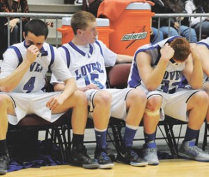 Sorrow could be seen on the faces of the Lovell boys basketball team near the end of the championship game loss to the Wyoming Indian Chiefs Saturday night at the Casper Events Center. Pictured are (l-r) Colin May, McKayan May and Dylan Hultgren.