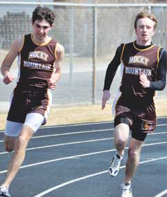 Rocky Mountain junior Brady Winland (left) and senior Austin Brost steam around the corner in the 200-meter dash Saturday in Greybull.