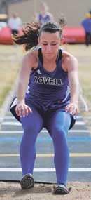 Lovell senior Alyssa hits the pit in the triple jump during the recent Riverside High School Invitational. Geiser was named the female athlete of the week this week for her performance at the Wind River meet. David Peck photo