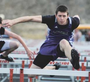 Lovell junior Nathan Ballard sails over the hurdles in the 110-meter high hurdles Friday in Basin. Ballard placed fourth with a personal-record time of 18.21.