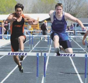 Lovell senior Mark Grant powers over a hurdle in the lead during the 300-meter intermediate hurdles race Saturday at the Lovell Invitational. Grant won the race in a time of 43.55. David Peck photo