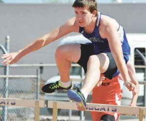 Lovell sophomore Derek Phelps cruises over a hurdle during the Thermopolis Pre-Regional Friday. Phelps slashed his time in both hurdles races Friday. Nathan Oster photo