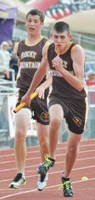 Rocky Mountain freshman Kirby Winland takes the baton from fellow freshman Cannon Simmons during the 400-meter relay Friday in Casper.