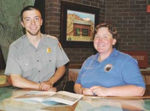 Bighorn Canyon NRA Chief Interpretive Ranger Christy Fleming chats with seasonal interpreter John Kissner at the Cal S. Taggart Visitor Center last week.