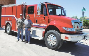 Lovell Fire Capt. Bob Mangus and Fire Chief Jim Minchow stand in front of the department's new extrication truck that has many modern features.