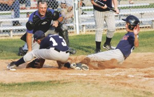 Braves pitcher Tristan Jewell covers home plate as Lathan May slides in to score a run for the Twins as umpire Doug Arnold observes during Thursday's title game.