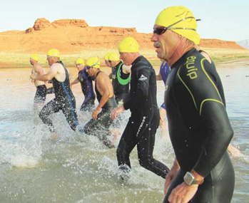 Triathletes enter the water in the 2012 Bighorn Lake Triathlon.