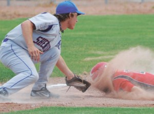 Baseball can be a rough sport. Not only is Steven Pickett out at third trying to advance from first base on a single, he takes a face full of dirt in the process during the Lovell Mustangs' 11-1 win over the Sheridan Jets Tuesday afternoon in Cowley.