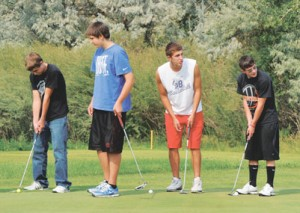 Working on their putting during practice Tuesday evening are Lovell Bulldog golfers (l-r) Sloan Colvin, CJ Murphey, Brandon Wolvington and Chase Tippetts.