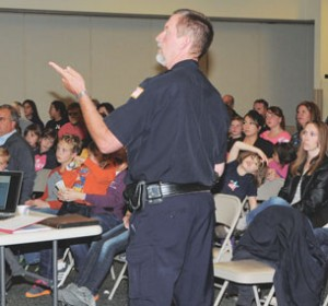 Lovell Chief of Police Nick Lewis discusses child safety tips with parents and children during a meeting Monday evening at the Lovell Community Center. Lewis said his PowerPoint presentation is available to anyone who would like it.