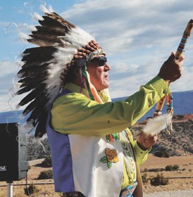 Crow Tribe Cultural Director Burton Pretty On Top gives a blessing in four directions during an opening pipe ceremony that was part of the Two Eagles Interpretive Trail dedication Saturday morning.