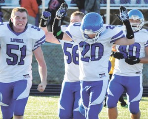 Senior Jacob Beck (51) and teammates Morgan May (58), Calin McArthur (20) and Aaron Monterde (40) celebrate following Lovell's dramatic 29-28 win over Big Horn Friday afternoon.