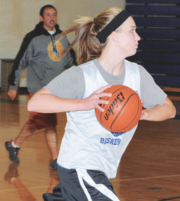 Kassi Renner races down the court during a fast-break drill Monday afternoon at the LHS Gym.