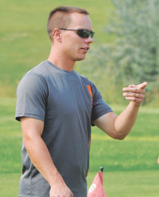 Devon Parks instructs his golfers in an early season practice.