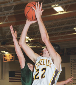 Rocky Mountain sophomore center Kirby Winland powers for two points against the Tongue River Eagles on Friday afternoon in Cowley. The Grizzlies swept Tongue River and Wind River over the weekend and host Burlington Saturday afternoon.