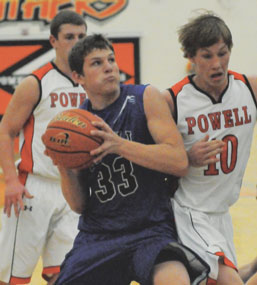 David PeckSenior forward Ryan Clark muscles for two points as Powell's Hayden Cragoe defends during Lovell's 62-50 win Thursday night in Powell. Clark finished the game with 17 points.