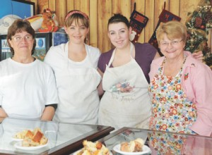 Posing at the front counter in the new Mama's Baked Goods store on Main Street in Lovell are (l-r) staff members Rhonda Wipf, Amanda Ballard, Raven Roberts and Nancy Blair.