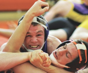 Lovell senior Jacob Beck puts the squeeze on an opponent during the Powell Roundtable Invitational Saturday. Beck won the title at 170 pounds.