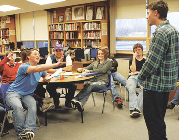 The speech and debate team practiced their improvisational skills this week in anticipation of an upcoming performance for Lovell Elementary School. Above, Cole Moncur gets a dose of constructive criticism from his teammates after a practice performance on Tuesday afternoon in the LHS library.