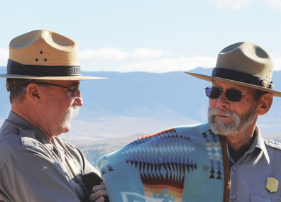 Bighorn Canyon National Recreation Area Supt. Jerry Case presents retiring archaeologist Chris Finley (right) with a blanket and other gifts during the dedication of the Two Eagles Interpretive Trail on Oct. 20.
