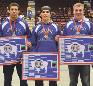 Posing with their state championship brackets following the final round of the state wrestling tournament Saturday are (middle, l-r) Dino Collins, Nathan Grant and Jacob Beck.