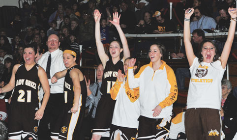 The Rocky Mountain bench erupts with joy following a key basket late in the Lady Grizzlies' 58-54 win over Wyoming Indian Saturday morning that propelled the Grizz into the state tournament this week. Pictured are (l-r) Rachael Allred, Coach Ryan Boettcher, Hannah Parker, Coach Eric Honeyman, Mikaela Hocker, Maddie Crawford, Sarah Jones and Courtney Tyacke.