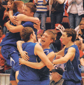 The Lovell Bulldogs leap and hug for joy at the final horn after defeating the Lusk Tigers 46-35 in Saturday night's 2A championship game. Pictured are (l-r) Dylan Hultgren, Kade Nicholls, Ryan Clark, Jacob Adey and Seth Kite.