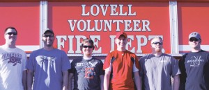 A group of six new volunteer firemen, including (l-r) Matt Koritnik, Roger Haney, Tyler Stahl, Seth Mayes, Brandon Jolley and Craig Winterholler, took a stress test on the track at Lovell High School last week. The men began their training to be firefighters last month.