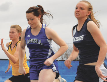 Lovell senior Kassidy Hetland bears down as she powers toward the finish line in the 100-meter dash Saturday at the Lovell Invitational. Hetland placed eighth.