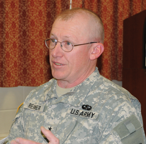 Wyoming Adjutant General Luke Reiner makes a point during a meeting with Lovell community leaders Friday morning.