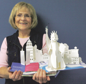 Chauna Bischoff was named Big Horn County School District No. Two teacher of the year. Bischoff is shown here with a pop-up book featuring national landmarks that she uses to teach both facts and music simultaneously to her students.