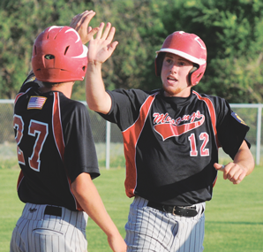 Dylan Hultgren crosses home plate and is greeted by Caleb Horrocks during the Lovell Mustangs' 8-6 win over Riverton last Wednesday evening in Riverton. Both scored on a triple by Calder Forcella. David Peck photo