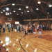 People, many of them from out of town, linger to chat and recall memories during the open house at the Cowley Log Gym Saturday afternoon.  David Peck photo