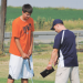 Lovell High School golf coach Devon Parks works with C.J. Murphey during a recent practice. The LHS golfers travel to Worland this week for their second tournament. David Peck photo
