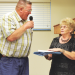 Museum board members Rich Fink and Karen Spragg have some good-natured fun at the museum fundraiser while announcing winners of the silent auction items on Saturday, Aug. 17, at the Lovell Community Center.  Patti Carpenter photo