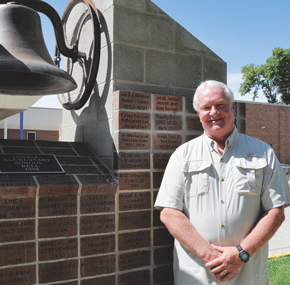 Jerry Anderson poses in front of the bell tower at the Lovell Elementary School, the final school he taught at during his 18-year career. David Peck photo