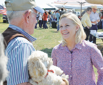 U.S. Senate candidate Liz Cheney visits with citizens at the Big Horn Basin Tea Party picnic near Emblem on Saturday. Nathan Oster photo