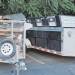 The cardboard trailer, left, and the multi-bin trailer stationed at the Red Apple parking lot are filling rapidly each week, thanks to the success of the Lovell recycling program, but more help is needed to transport the material to Powell. David Peck photo
