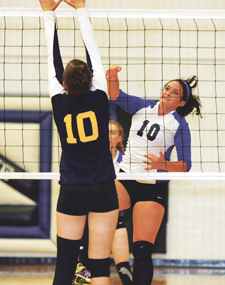 Outside hitter Mercedes Haney slams one past the competition at the North Big Horn Volleyball Tournament held earlier in the season. Patti Carpenter photo
