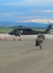 Justin Durtsche, a captain in the Wyoming National Guard, walks toward a  Black Hawk helicopter he is piloting this week as part of the Charlie Med unit that was activated on Sunday to provide air medical evacuation support to victims stranded in flood zones in Colorado. Courtesy photo