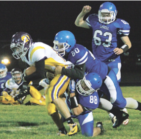 Drake Welch (88) and Nash Jolley (60) hit a Thermopolis player as Zeke Collins (63) moves in to help during Lovell's win over the Bobcats Friday night at Robertson Stadium. Cindy Asay photo