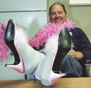 Big Horn County Sheriff Ken Blackburn kicks up his heels at a special benefit designed to raise awareness about victims of domestic violence and to raise funds for the CARES organization that helps victims of violence in Big Horn County.  Patti Carpenter photo