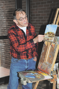 Powell artist Martin Garhart points out aspects of NeVille's work.  David Peck photo